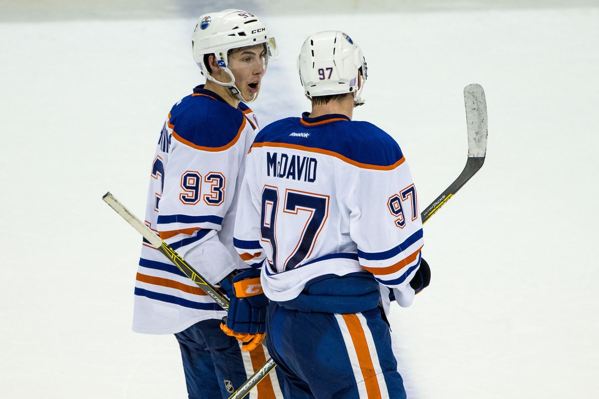 Edmonton Oilers forwards Connor McDavid (97) and forward Ryan Nugent-Hopkins  (93) in discussion at center ice. Mandatory Credit  Brace Hemmelgarn-USA  TODAY ... af75437e3