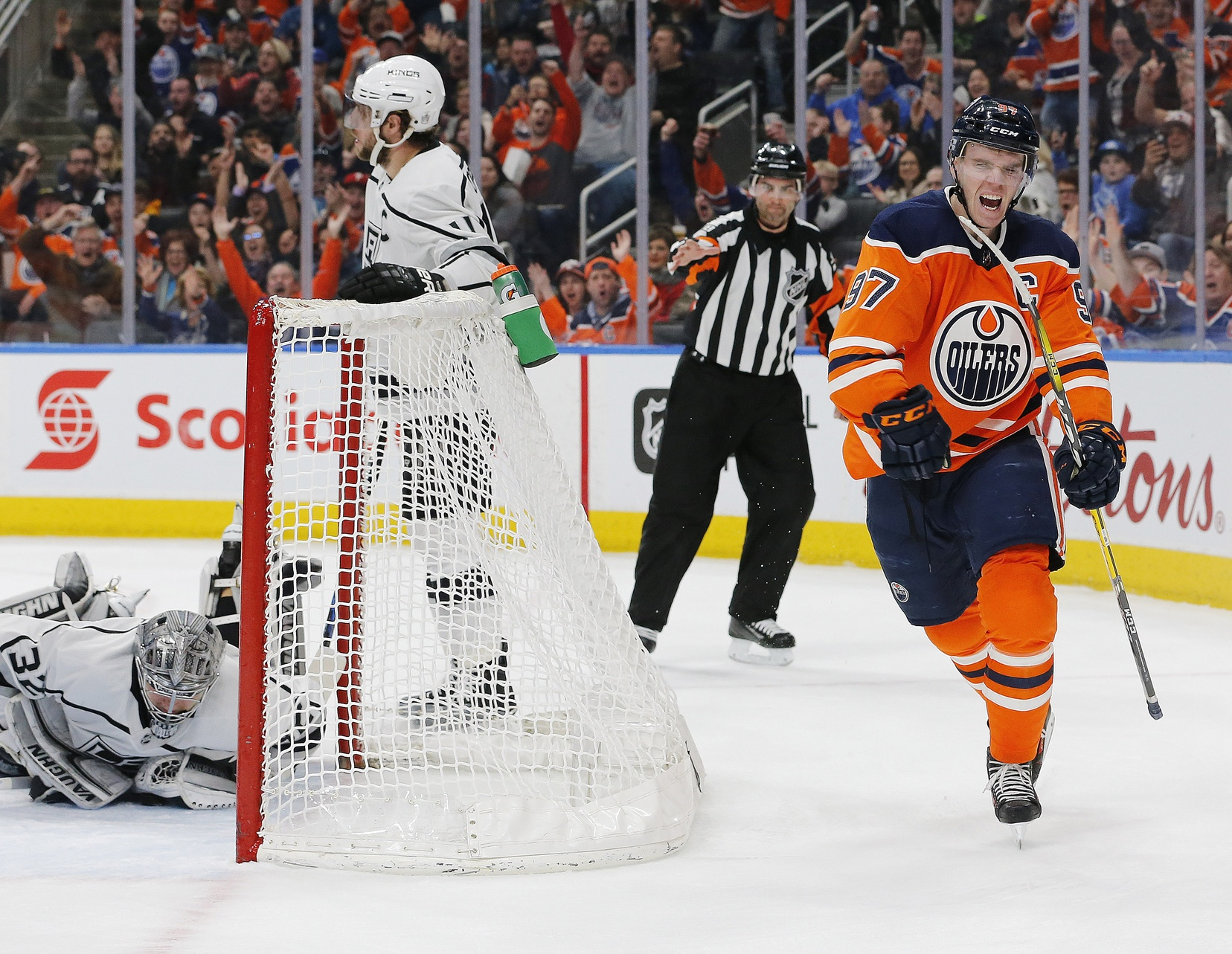 Connor-mcdavid-oilers-scores-on-jonathan-quick-kings-while-anze-kopitar-stands-by