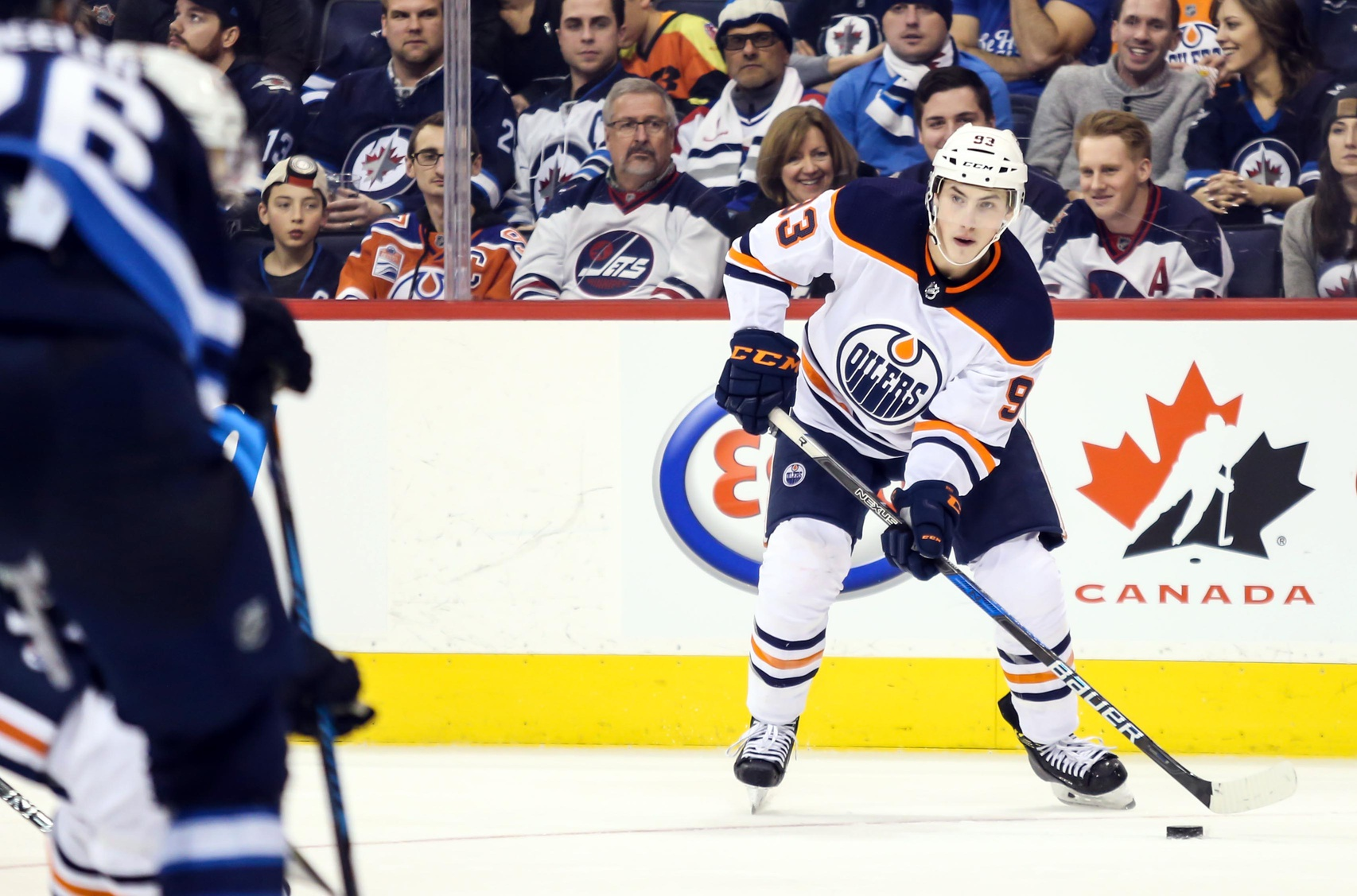 Edmonton-oilers-centre-ryan-nugent-hopkins-with-puck-against-winnipeg-jets