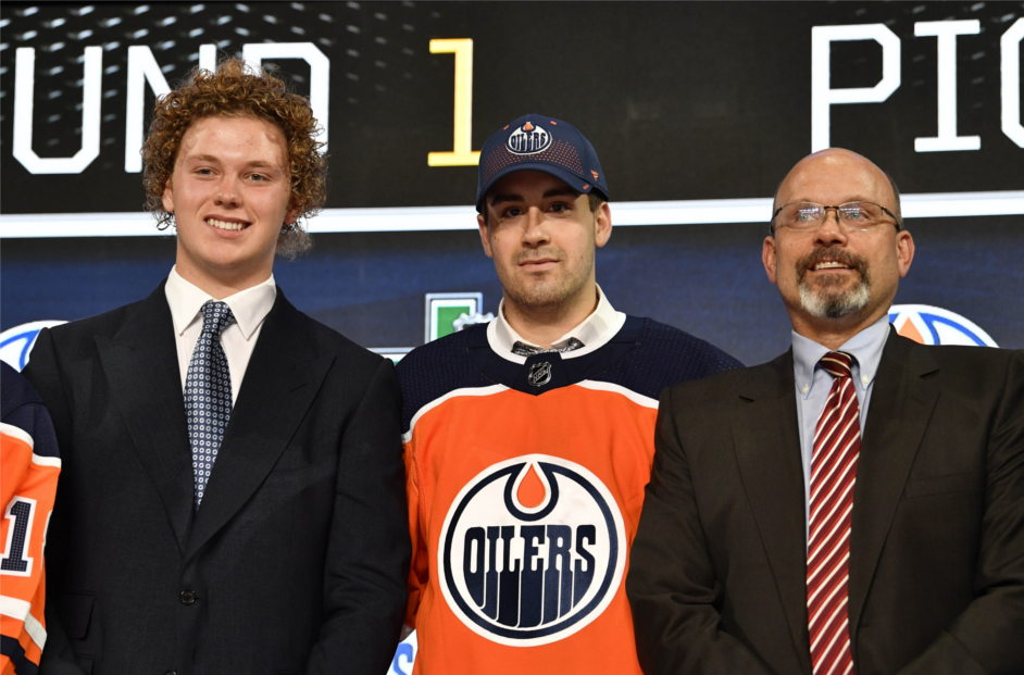 Edmonton-oilers-10th-overall-pick-evan-bouchard-stands-with-harrison-katz-and-general-manager-peter-chiarelli