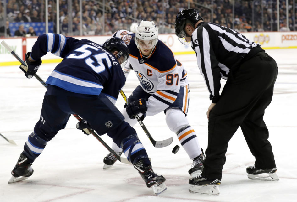 Edmonton-oilers-captain-connor-mcdavid-faces-off-against-winnipeg-jets-centre-mark-scheifele